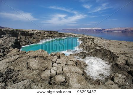he Dead Sea also called the Salt Sea is a salt lake bordered by Jordan to the east and Israel and the West Bank to the west. Its surface and shores are 429 metres below sea level Earth's lowest elevation on land. The Dead Sea is 304 m deep the deepest hyp