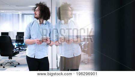 young casual businessman using tablet computer in startup office