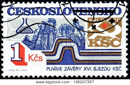 UKRAINE - CIRCA 2017: A stamp printed in Czechoslovakia shows Chemical industry from series 16th Communist Party Congress goals and projects circa 1983