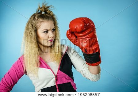 Funny Confused Woman Wearing Boxing Glove