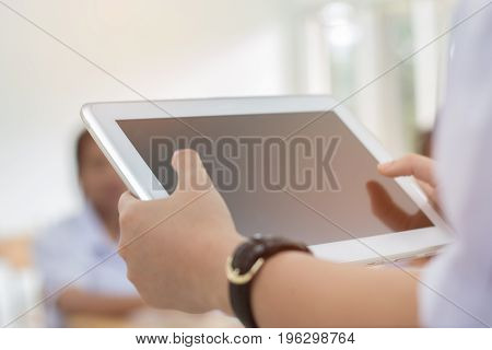 blurred of student testing in exercise exams answer on a tablet computer in elementary high school lesson in class room for test exams online education by finger clicking
