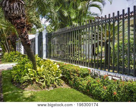 Detail view of elegant house with garden at urdesa neighborhood district in Guayaquil Ecuador