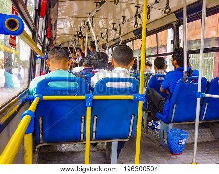 GUAYAQUIL, ECUADOR, NOVEMBER - 2016 - People sitting at interior public bus in Guayaquil Ecuador