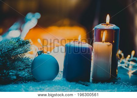 christmas decoration with christmas bauble and candle for advent season four candles burning.