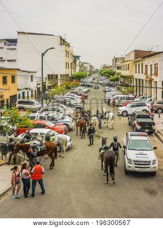 GUAYAQUIL, ECUADOR, NOVEMBER - 2016 - Group of polices with horses around the stadium in a soccer game played in Guayaquil city Ecuador