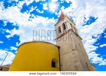 View at old stone architecture tower in Makarska town, croatian historic landmarks in Europe.