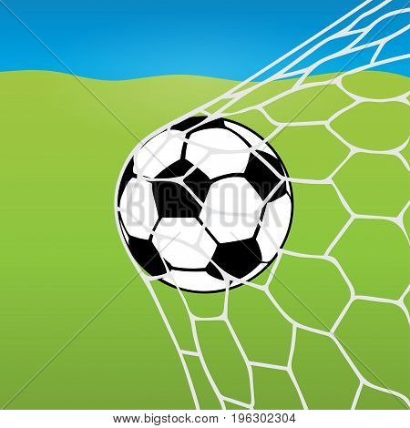 Soccer ball flying into the net, ball in goal against the background of a football lawn and blue sky