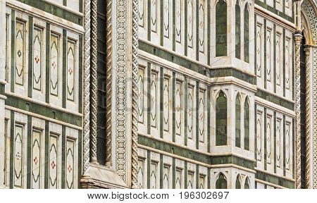 Detail of the external wall of the Duomo of Florence. Outdoor shot. Nobody