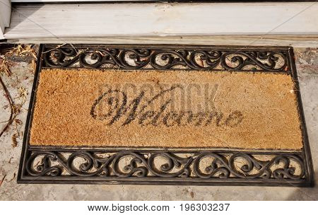 A well used front door welcome mat