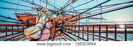 The mast of an on sailing ship on the California coast.