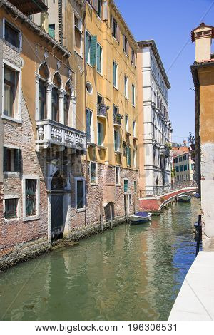 Venice Veneto Italy - June 20 2017. Very narrow channel. A typical alley of the old part of the island of Venice.