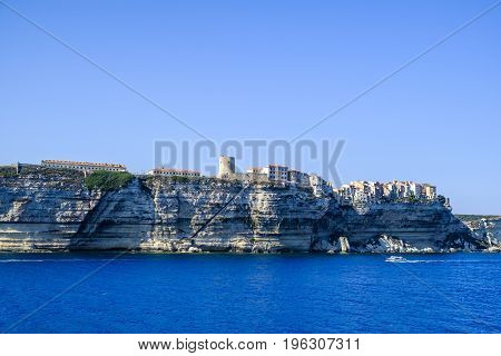 Beautiful old town of Bonifacio on French Mediterranean island of Corsica perched on top of layered rock cliffs
