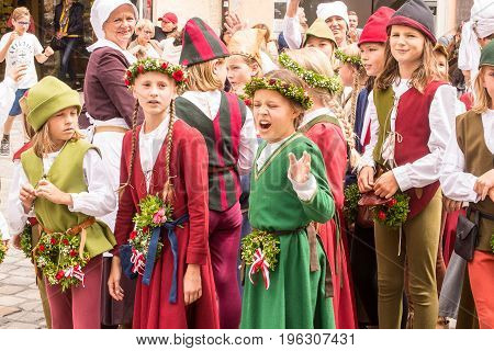 LandshutGermany 15 th July 2017:a group of children in medieval costumes walk in the street