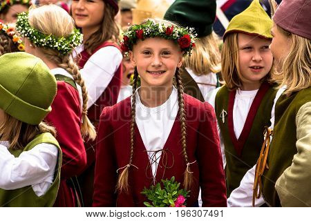 LandshutGermany-July 152017: A girl taking part in this year's Landshut Wedding smiles for a photo.