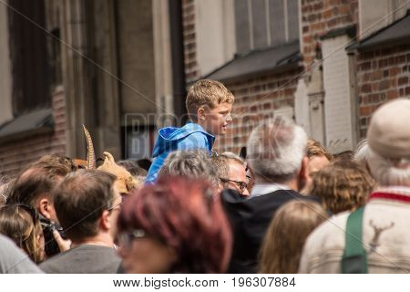 Landshut,Germany-July 15,2017:A man carries his son on his shoulders through the crowds