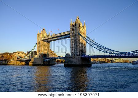 Late afternoon winter sunshine on iconic Tower Bridge in London England