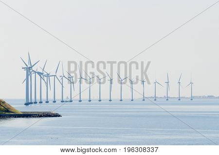 Wind powered electrical generators located in the ocean near Copenhagen harbor, an illustration of how Danes are committed to green enrgy
