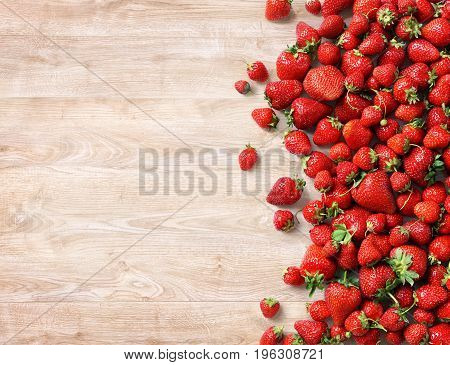 Fresh strawberry on wooden background. Fruits diet concept. Copy space. Top view high resolution product.