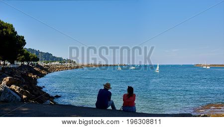 Hondarribia Spain - July 16 2017. People in front of Txingudi bay at the mouth of the Bidasoa river in Hondarribia (Fuenterrabia). Gipuzkoa Basque country Spain.