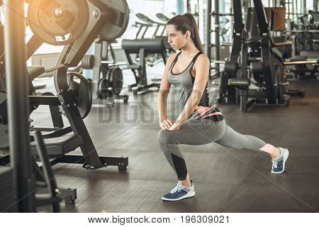 Young female exercise in the gym, workout