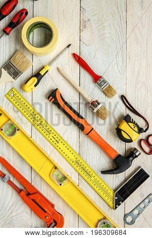 Repairment equipment objects isolated on wooden surface no people