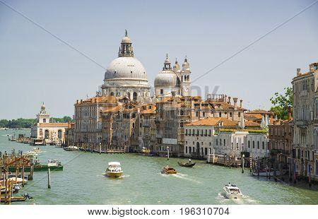 The Grand Canal and the Basilica of Santa Maria della Salute Venice Italy - June 20 2017.