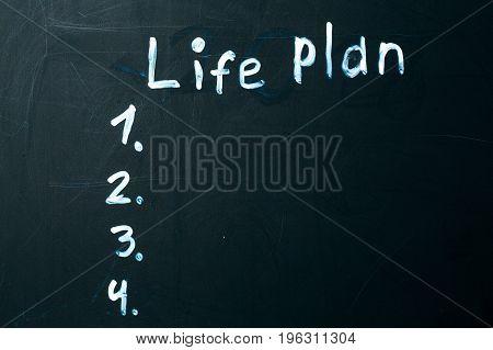 LIFE PLAN phrase written in chalk on the blackboard
