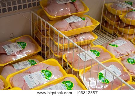 Voronezh, Russia - May 25, 2017: Packages with chicken half-finished products in the store fridge