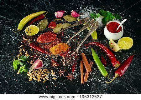 Spice set and  herbs on dark background