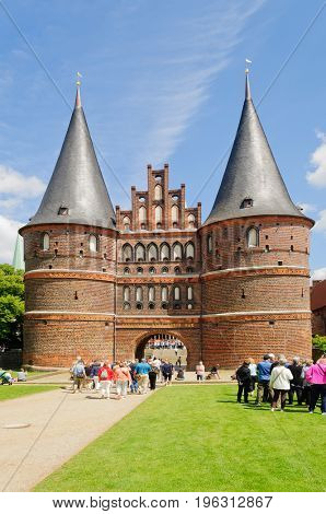 Lubeck, Germany-July 05,2017: Holsten Gate, built in the 1400's, subsequently renovated several times, the most recent in 2003, and the symbolic icon of the City of Lubeck