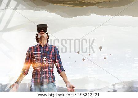 Man in virtual helmet . Mixed media