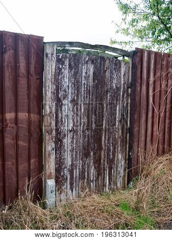 old and rustic wood garden gate and fence; Essex; UK