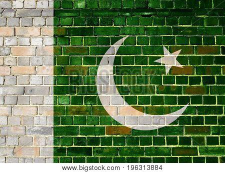 Pakistani flag on an old brick wall background