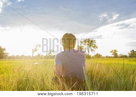 Man Traveler With Backpack And Looking At Wide Fields Are Golden And Green In The Morning Sunrise Br