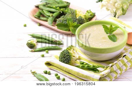 Broccoli And Green Peas Puree Soup Decorated With Mint