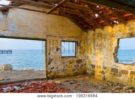 View Through Derelict House Window By The Beach