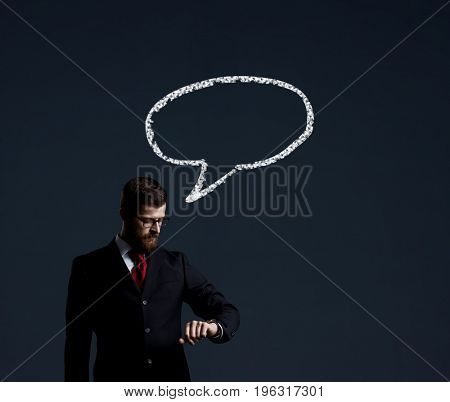 Businessman with briefcase standing over dark dramatic background. Business and office, concept.