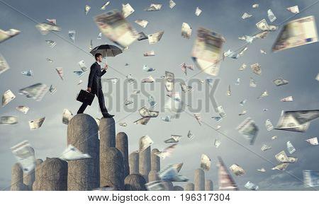 Elegant banker with umbrella. Mixed media