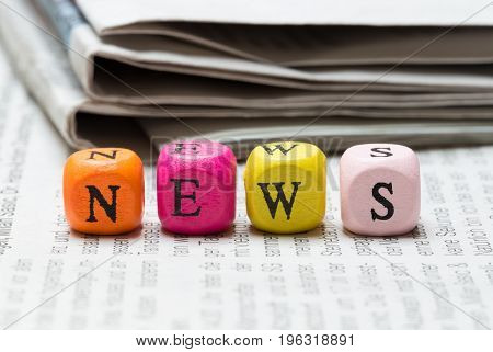 News letter cubes on newspaper macro detail picture