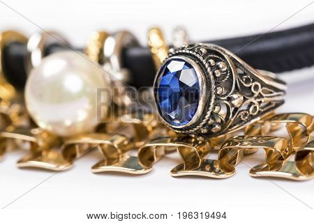Gold ringsblue sapphire jewelry and pearl on a white background