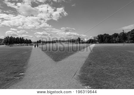 Walkways on the Ehrenbreitstein plateau in Koblenz Germany with the fortress and the cable car station in the background