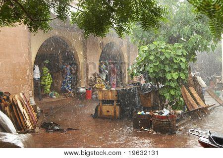 Rainstorm at market in Bamako, Africa