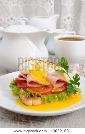 Toast with slices of ham and tomatoes Benedict egg with Dutch sauce for Breakfast