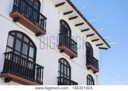 Traditional colonial style wood balconies on side of multi-level building in San Cristobal de las Casas Chiapas Mexico