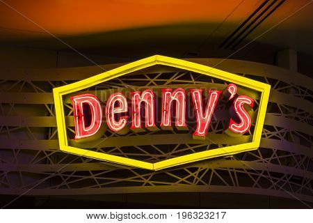 Las Vegas - Circa July 2017: Neon Logo and signage of a Denny's Coffee Shop. Denny's is America's Diner VI