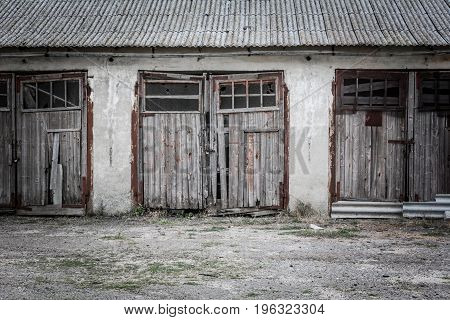 Old wooden garage doors for agricultural machinery