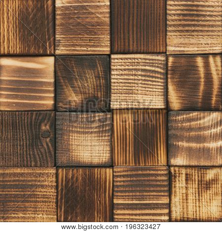 Rustic wood background. Dark wooden blocks.