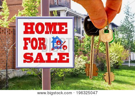 The keys to the house on the background Billboard of sale .