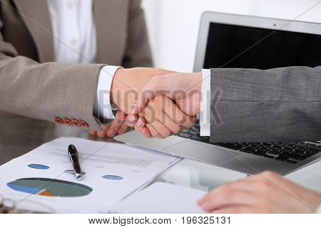 Business handshake. Two women are shaking hands after meeting or negotiation