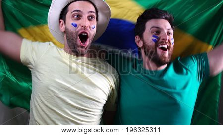 Brazilian Friends Celebrating with Brazil Flag